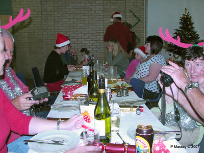 Christmas Dinner - Barbie, Mike, Ben, Sarah [Charles with blue tinsel], Angela with Jenny & Martin behind, Pippa, Becky [Beth behind], Ros and Barry's arms
