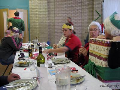 Christmas Dinner - Beverley M, Scarlet & Chris F at door, Alex behind Zoe [Jenny blurred behind], Janet & Felicity.