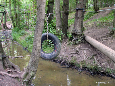 "No 2 - Log Bridge - ""Make your way over the stream on the log with a single rope handrail."" This was easy for everyone."