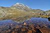 Besshø i Jotunheimen spegler seg i vatn<br /> <br /> Mt.Besshø in Jotunheimen mountain area,Norway