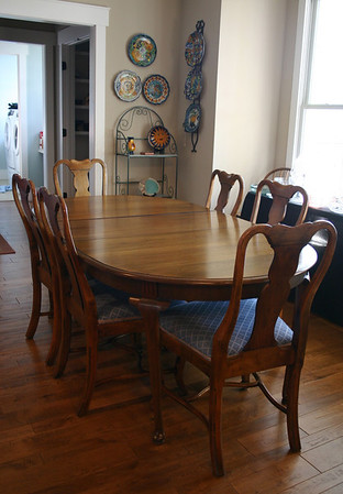 SOLID walnut dining table w/8 chairs, two leaves and pads.  (Only one leaf and 6 chairs are shown.)