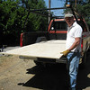 c-clamp / wheel device carries half the weight of the sheet.