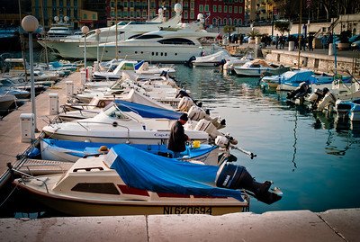 Man cleaning his boat in Port of Nice, French Riviera, France
