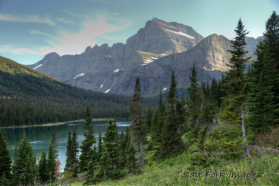 Mount Gould stands watch above Lake Josephine - Glacier National Park, Montana