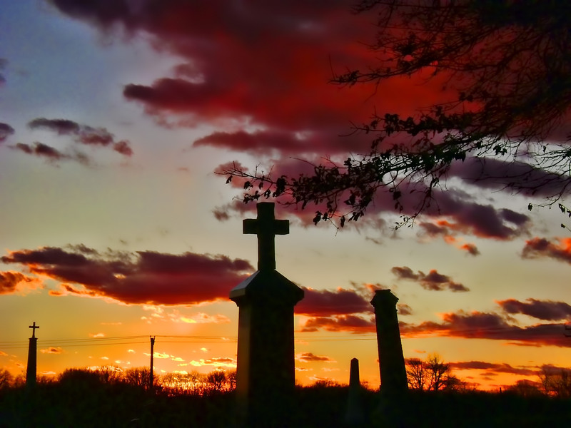 I was driving home and in a matter of seconds the sky turned crimson and orange. The cemetery was right there so I turned in and made this photo. PP with Topaz Adjust. 1.1.12