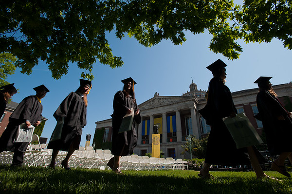 Students walk past Rush Rhees Library during the recessional. // University of Rochester College College of Arts and Sciences commencement ceremony at the River Campus May 20, 2012.  // photo by J. Adam Fenster / University of Rochester
