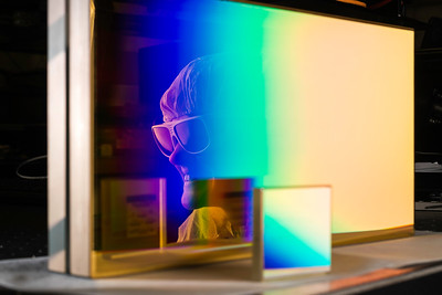 Graduate Student in the Plasma and Ultrafast Physics Group Sara Bucht is reflected in a grating used in research in her lab at the Laboratory for Laser Energetics December 6, 2018. THe smaller grating in front was used by Nobel prize winner Donna Strickland in her research at the LLE in the 1980s. Bucht is using CPA to make a novel laser that will be used for laser-plasma amplifiers. Laser-plasma amplifiers could lead to a paradigm shift in short-pulse laser amplification (much like CPA did 30 years ago) and provide the enabling technology for achieving intensities necessary for strong field quantum electrodynamics research (potentially the next graduate student project to be recognized by the Nobel committee)  // photo by J. Adam Fenster / University of Rochester