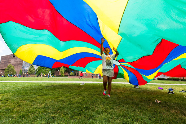 Sereniti Jackson plays with a parachute. // Student participants engage in Health Hero Time during Horizons at Warner, a six-week summer enrichment program that engages K–8 Rochester City School District students at University of Rochester's Warner School of Education are pictured August 3, 2017.  // photo by J. Adam Fenster / University of Rochester