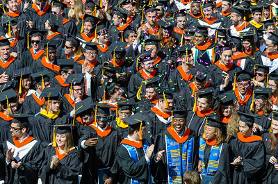 Graduates celebrate as degrees are conferred. // University of Rochester College of Arts and Sciences commencement ceremony at the River Campus May 18, 2014. // photo by J. Adam Fenster / University of Rochester