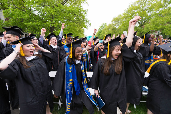 Graduates celebrate as degrees are conferred and rain begins to fall.   // University of Rochester Arts, Sciences & Engineering commencement ceremony at the River Campus May 21, 2017.  // photo by J. Adam Fenster / University of Rochester