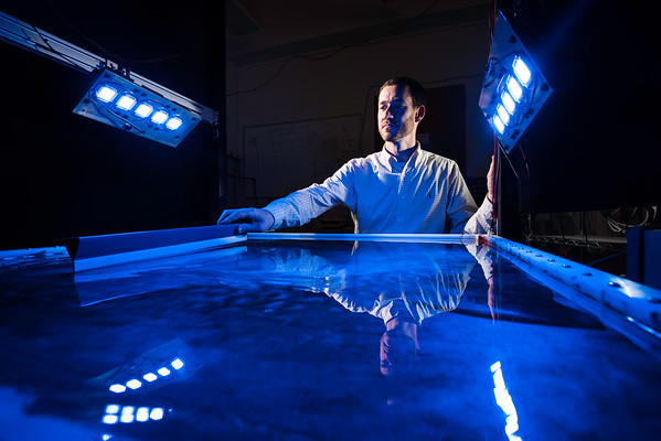 University of Rochester Assistant Professor of Mechanical Engineering Douglas H. Kelley is pictured with a device used by his research group to model turbulence occurrences to learn how they affect plankton ecology in his lab in Hopeman Hall March 8, 2016. Kelley recently received an NSF CAREER Award to build multiphase models of fluid mixing in liquid metal batteries. // photo by J. Adam Fenster / University of Rochester