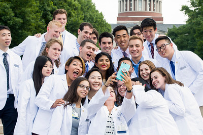First year med student Susan Greenman takes a self with fellow students of her advisory group on the quad steps after the ceremony. // University of Rochester School of Medicine & Dentistry holds its Eleventh Annual Dr. Robert L. & Lillian H. Brent White Coat Ceremony for the Class of 2020 at the Interfaith Chapel August 12, 2016.   // photo by J. Adam Fenster / University of Rochester