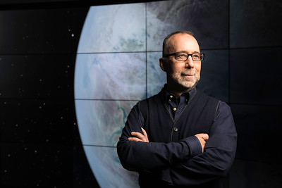Adam Frank, professor of physics and astronomy, is pictured at the VISTA Collaboratory at the University of Rochester June 4, 2018. // photo by J. Adam Fenster / University of Rochester