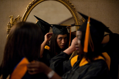 l-r: Danielle Ambeau, Aundrea Soong, and Anna Asiama get ready at a mirror. University of Rochester School of Nursing Commencement at Eastman Theatre May 14, 2010.  // photo:  J. Adam Fenster/University of Rochester