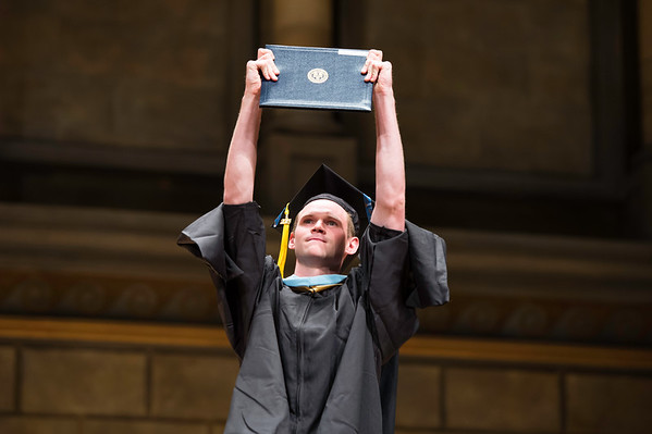 Tyler Socash holds up his diploma. // University of Rochester Warner Graduate School of Education and Human Development Commencement Ceremony in Kodak Hall at Eastman Theatre May 16, 2015. // photo by J. Adam Fenster / University of Rochester