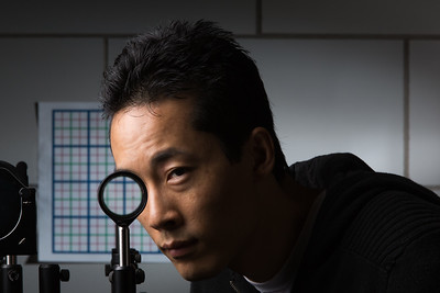 Ph.D. student Joseph Choi is pictured with a multidirectional `perfect paraxial' cloak using 4 lenses designed by himself and University of Rochester professor of physics John C. Howell September 11, 2014.  // photo by J. Adam Fenster / University of Rochester