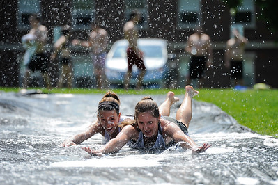 Niki Holmes, left and Kayliegh Hogan // University of Rochester Hajim School of Engineering seniors enjoy a slip and slide on a sunny afternoon outside Goergen Athletic Center May 15, 2012.  // photo by J. Adam Fenster / University of Rochester
