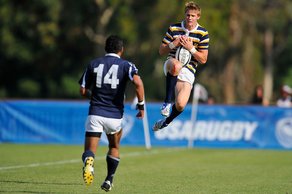 02 May 2008:  California's Colin Hawley (striped) makes a catch during California's 59-7 victory over BYU in the Collegiate Division I Men's Rugby National Final match at Stanford University's Stueber Rugby Stadium in Stanford, CA.  The California win represents its fifth straight national rugby championship.