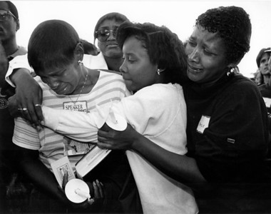 Shirley Hughes (left), mother of Tony Hughes, whose remains were among those of 11 males found in the apartment of Jeffrey L. Dahmer, is supported by family before a march along Kilbourn Avenue in remembrance of the victims.