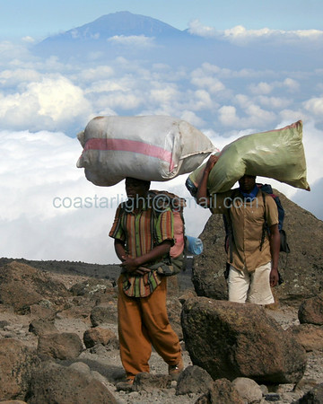 """Kilimanjaro porters. The Adirondack Review featured this image in their Spring 2010 issue: <br />  <a href=""""http://www.theadirondackreview.com/BrandonLingle.html"""">http://www.theadirondackreview.com/BrandonLingle.html</a><br /> <br /> Click here for more like this: <a href=""""http://coastarlight.smugmug.com/Places/Tanzania/9613388_pyjet"""">http://coastarlight.smugmug.com/Places/Tanzania/9613388_pyjet</a><br /> © Brandon Lingle"""