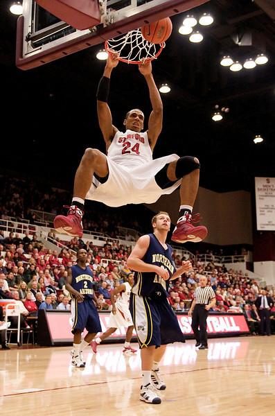 17 December 2008: Stanford Cardinal forward Josh Owens (24) dunks the ball over Northern Arizona Lumberjacks guard Josh Wilson (21) during the first half of the Cardinal's 66-57 win over the Lumberjacks at Maples Pavilion in Stanford, California.