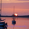 Sunset over harbor inlet at Morro Bay, California.