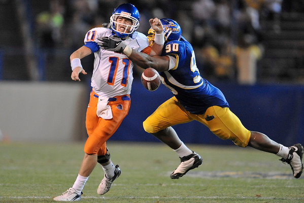 Oct. 24, 2008; San Jose, CA, USA; San Jose State defensive end Jarron Gilbert (90) sacks Boise State quarterback Kellen Moore (11) and causes a fumble in the third quarter of the Broncos 33-16 victory over the Spartans at Spartan Stadium in San Jose, CA. Mandatory Credit: Daniel R. Harris-US PRESSWIRE