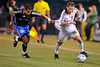 14 June 2008:  Jason Hernandez (21) pulls on a jersey as Ely Allen (26) dribbles past during the Los Angeles Galaxy's 3-0 victory over the San Jose Earthquakes at McAfee Coliseum in Oakland, CA.