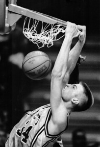 Freshman center Jim Mcilvaine slams one home during Marquette's 76-65 loss to Butler Saturday at the Bradley Center.
