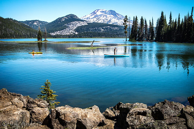 Stand-up paddling, Sparks Lake, Oregon  That is South Sister of the Three Sisters collection of mountains in Deschutes County, central Oregon.