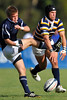 02 May 2008:  Joseph Welch blocks a kick by Shaun Michael Davies (blue) during California's 59-7 victory over BYU in the Collegiate Division I Men's Rugby National Final match at Stanford University's Stueber Rugby Stadium in Stanford, CA.  The California win represents its fifth straight national rugby championship.