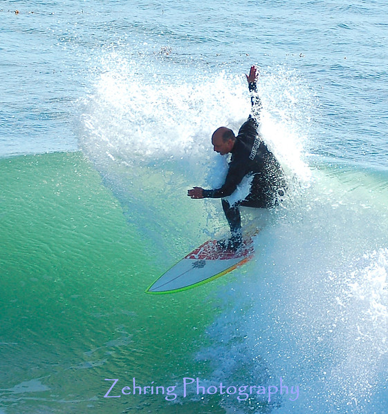 """Dropping down"" on nicely formed shoulder on an average to smaller day in Santa Cruz, Ca."