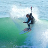 """""""Dropping down"""" on nicely formed shoulder on an average to smaller day in Santa Cruz, Ca."""