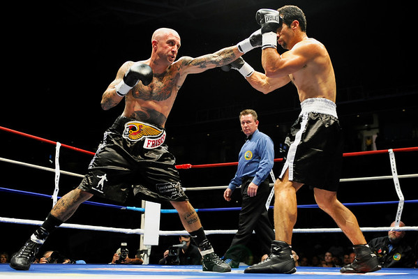 11 September 2008: Jason Peterson (black trim) and Gabriel Gil (white trim) during Gil's fourth round TKO super middleweight victory at the HP Pavilion in San Jose, CA.