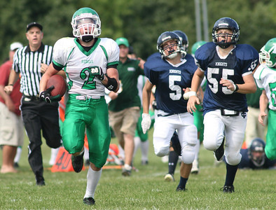 Ridgewood's P.J. O'Connor makes a break from IC's Ben Goworowski (No. 55) and Nick Mrugacz.