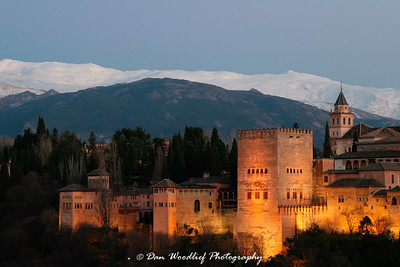 The Alhambra Palace at dusk and the Sierra Nevada Mountains - Granada, Spain.