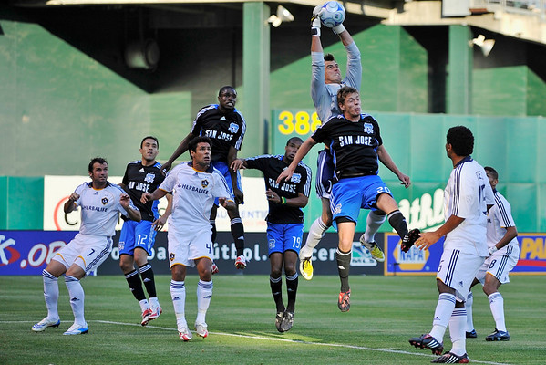14 June 2008:  Steve Cronin (1) jumps over John Cunliffe (20) to save a goal during the Los Angeles Galaxy's 3-0 victory over the San Jose Earthquakes at McAfee Coliseum in Oakland, CA.