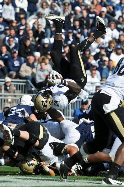 BRIAN POMEROY | Senior Photographer<br /> Junior running back Akeem Shavers flips over the top of the pile to score Purdue's second touchdown during the 18-23 loss to Penn State on Saturday.