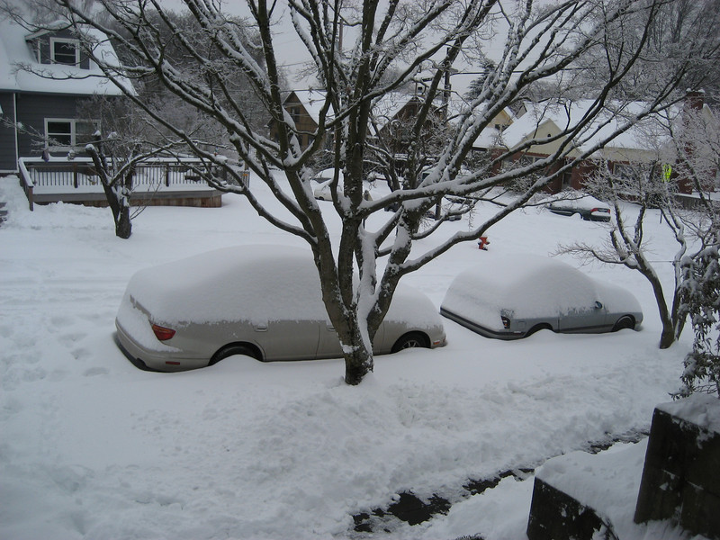 Record snowstorm -- Neal's car outside out house