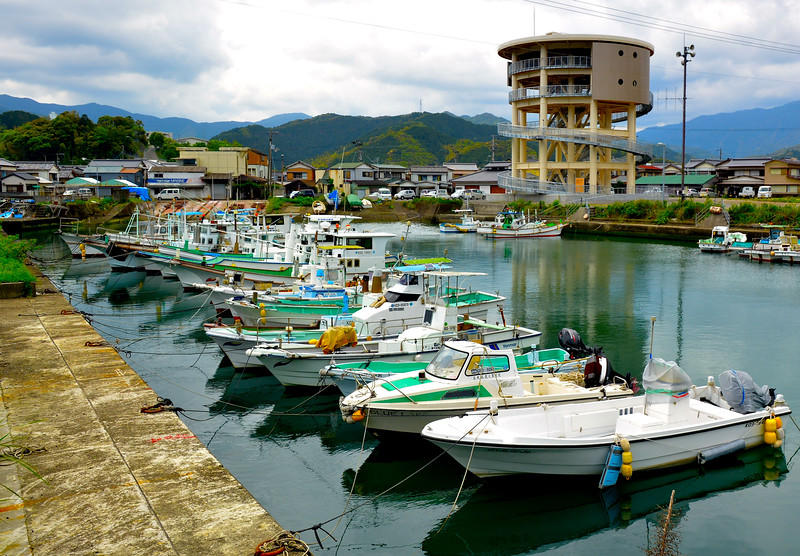 Kure town harbor, tsunami tower in the background