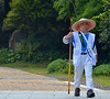Pilgrim, walking to one 88 sacred Buddhist temple sites on the island of Shikoku.  His garb is worn by all pilgrims to these sites.