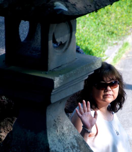Chiyo next to stone lantern