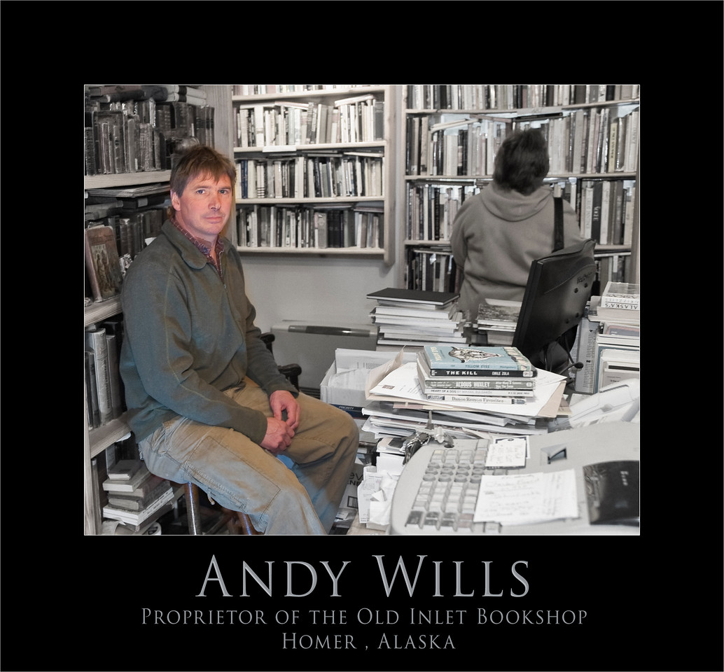 "Andy Wills, Entrepreneur, book seller, master of many crafts. Andy and his wife, Sally, own and run the bookshop, the Mermaid Cafe that is in the same building and a great B&B apartment upstairs. If you are in Homer don't miss the chance to stop in.<br /> <br /> <a href=""http://www.oldinletbookshop.com/index2.html"">http://www.oldinletbookshop.com/index2.html</a><br /> <br /> Andy is a third generation book seller. He offers used, rare and out-of-print books, and has been operating in Homer since 1997.<br /> <br /> The shop has moved from its original location in the basement of the Old Inlet Trading Post to its new digs up the street, now located in a dovetail notch-constructed log cabin in historic Old Town. About 400 feet from the waters of Cook Inlet, the log structure, known as the Hansen House (because it was Burt Hansen who moved it from the south side of Kachemak Bay to its present location in the early 1930s), was one of Homer's very first stores. The provenance is still a mystery, but some locals believe the cabin was built on Yukon Island in 1905, making it one of the oldest buildings in Homer.<br /> <br /> <br /> Totally renovated, the cabin offers old pioneer charm to the add-on new construction that houses the Mermaid Cafe and B&B. The bookshop specializes in Alaskana, polar exploration, natural history, modern firsts, children's and medical books. We also offer a wide array of general stock in most genres.<br /> <br /> Of the 20,000-plus titles available for perusal, one might find a signed Rockwell Kent illustrated first edition Moby Dick in a dust jacket, or a John Muir Cruise of the Corwin with a manuscript tipped into it. There is the possibility of securing a paperback of a favorite fiction writer, or a naval text detailing all the major submarine battles of World War 11. <br /> <br /> Also available are original oil paintings by local artist James Buncak, oil paintings by Chicago artist Sue Spero, whale-bone and ivory carvings by Point Hope Eskimo Tom Fields, and photographs by renowned photographer G. Brad Lewis. <br /> <br /> Tech note: Color was created with a  5 image ""pseudo"" HDR ( 5 copies saved at different exposures in RAW and processed with Photomatix Pro)  B&W conversion was applied to the resulting base image  as a layer and ""washed"" away utilizing masks.  Difficult lighting situation: combination of incandescent, flourescent, and natural light.   Strobe with large diffuser is off camera to the right on the floor"