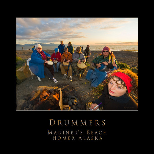 """When folks were gathering for the """"basket burning""""  this group of drummers kept them entertained and focused.   the beautiful young lady in the foreground is writing a note to someone to put on the basket  to burn and be sent to the sky.   Note the photographer with the ladder. You can see him again in """"burning the basket"""". I wonder if he got any good images."""