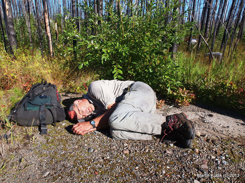 "For some the physical and mental stress was too much.  Here, an unidentified hiker curls up into a fetal position.  His last words were: ""Just leave me here, I will be OK, really."""