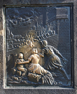 The plaque beneath the statue of St John of Nepomuk on Charles Bridge.. Poor John was tied up and thrown from the bridge in a sack and drowned in the River Vltava. His crime was  refusal to reveal the secrets of the Queens confessions to King Wenceslas in 1393. He is the National Saint of the Czech Republic and legend has it, if you place the palm of your right hand on this plaque, you will return again to Prague.