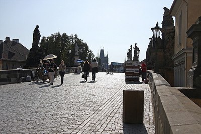 The incline and wayward line of Charles Bridge (Karlův most) is seen here from the Mala Strana side.  The 30 statues that line this famous bridge were placed there by the City Fathers in the 18th Century to inspire the population as they went to work. The bridge itself dates from the late 14th century! 23rd August 2009.