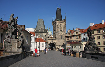 The Mala Strana end of Charles Bridge. You need to get up early in the morning to see this site so quiet ! Get there before 10am if you can !