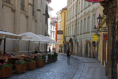 The winding narrow streets of Prague old town are best photographed before 10am. Any later and the area is transformed by the masses looking to shop, eat and drink! This view is of Karlova, looking towards Old Town Square.  23rd August 2009.