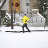Jogger Laurie Voelker, Westmont, runs along Luzerne street in the snow for her 5-mile workout before the Thanksgiving Holiday.